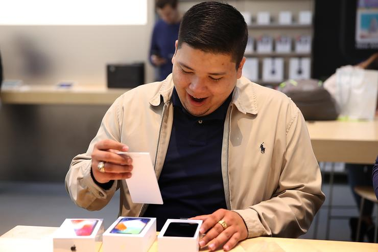 Apple customer David Casarez opens his new iPhone X at an Apple Store on November 3, 2017 in Palo Alto, California. The highly anticipated iPhone X went on sale around the world today