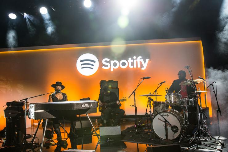 Musician D'Angelo (L) plays a private concert at a media event announcing updates to the music streaming application Spotify on May 20, 2015 in New York City. The latest updates include the ability to stream video content, podcasts and radio programs as well as original songs for the application