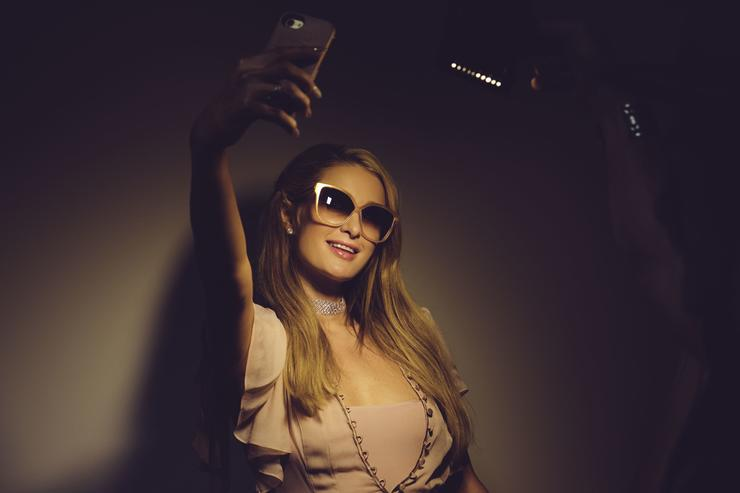 Paris Hilton poses for a selfie during a promotion visit to Australia to launch her 23rd fragrance, Rosé Rush on November 30, 2017 in Sydney, Australia