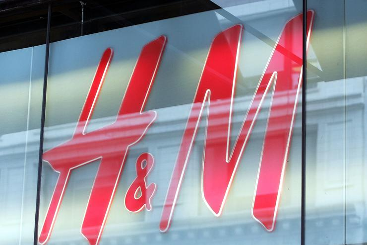 H&M sign hangs in a window April 7, 2005 in Chicago, Illinois. Sweden's Hennes & Mauritz, AB (H&M), Europe's largest fashion retailer, has said its first-quarter earnings rose 29 percent, the quickest pace in two years and pushed the stock to a five-year high. Wall Street reported overall retail sales in the U.S. were mixed for the month of March