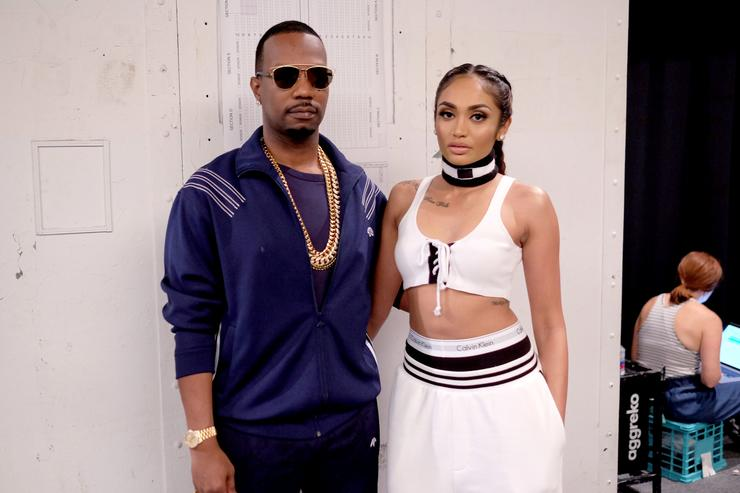 Juicy J and Regina Perera backstage at the Hood By Air fashion show during New York Fashion Week: The Shows at The Arc, Skylight at Moynihan Station on September 11, 2016 in New York City