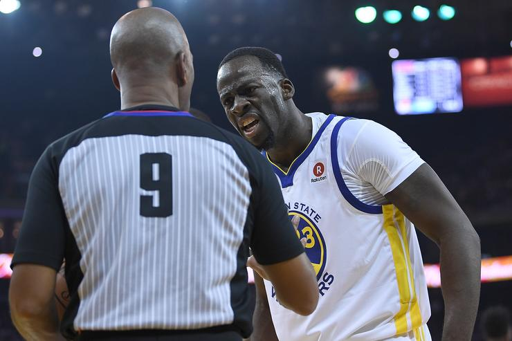 Draymond Green #23 of the Golden State Warriors complains to referee Derrick Stafford #9 of a no foul call during an NBA basketball game against the Cleveland Cavaliers at ORACLE Arena on December 25, 2017 in Oakland, California