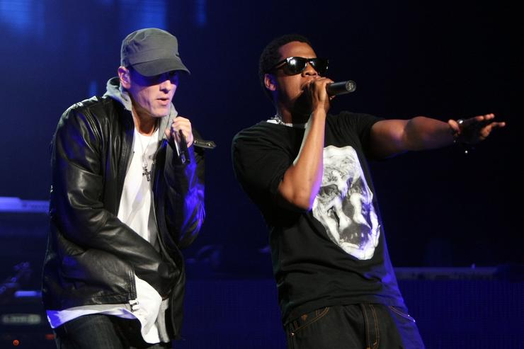 Rappers Jay-Z and Eminem perform together on-stage at the launch of 'DJ Hero' at the Wiltern Theatre on June 1, 2009 in Los Angeles, California