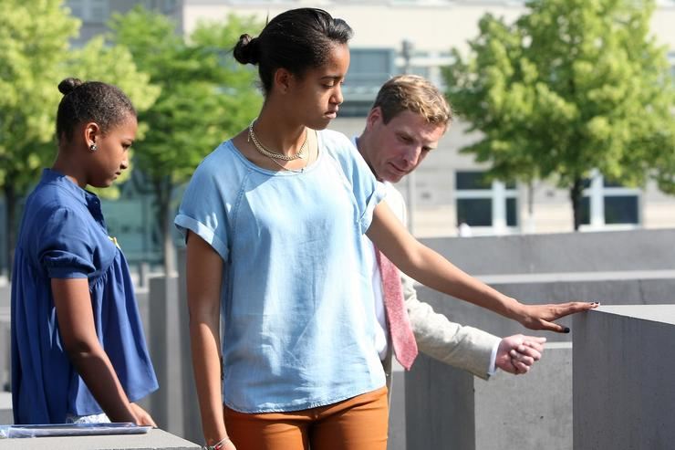 Malia Obama (C) touches one of the stelae at the Memorial to the Murdered Jews of Europe next to her sister Sasha (L) and Uwe Neumaerker, director of the foundation for the memorial, on June 19, 2013 in Berlin, Germany. U.S. President Barack Obama is visiting Berlin for the first time during his presidency and his speech at the Brandenburg Gate is to be the highlight. Obama will be speaking close to the 50th anniversary of the historic speech by then U.S. President John F. Kennedy in Berlin in 1963, during which he proclaimed the famous sentence: 'Ich bin ein Berliner.'