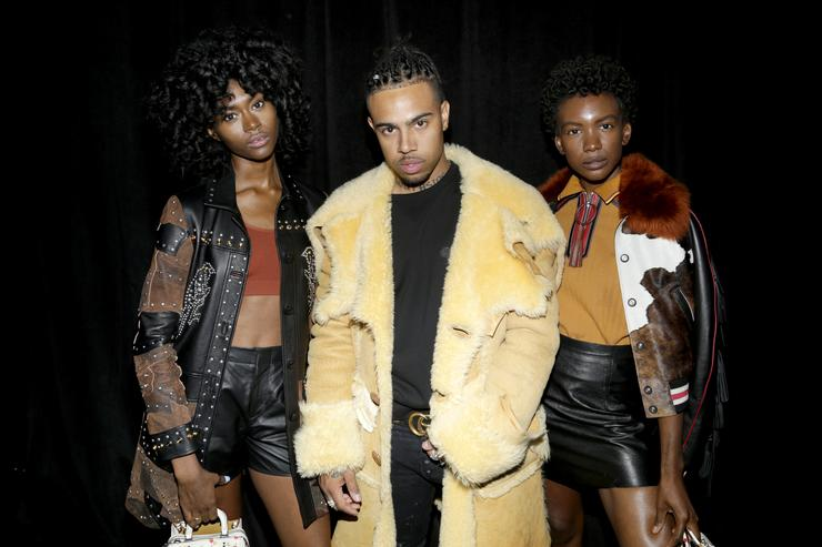 Isis Valentino, Vic Mensa, and Alexe Belle pose backstage during Coach Spring 2018 Fashion Show during New York Fashion Week at Basketball City - Pier 36 - South Street on September 12, 2017 in New York City.