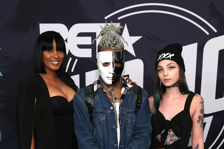 Rapper XXXTentacion (C) attends the BET Hip Hop Awards 2017 at The Fillmore Miami Beach at the Jackie Gleason Theater on October 6, 2017 in Miami Beach, Florida