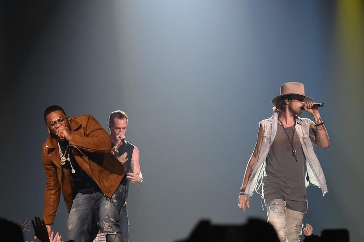 Singer/Songwriter Nelly joins Tyler Hubbard and Brian Kelly of Florida Georgia Line at FLG's Dig Your Roots 2016 Tour at Bridgestone Arena on October 13, 2016 in Nashville, Tennessee