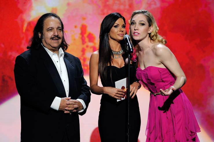 Adult film actor Ron Jeremy and adult film actresses Kirsten Price and Lily LaBeau present an award during the 29th annual Adult Video News Awards Show at The Joint inside the Hard Rock Hotel & Casino January 21, 2012 in Las Vegas, Nevada