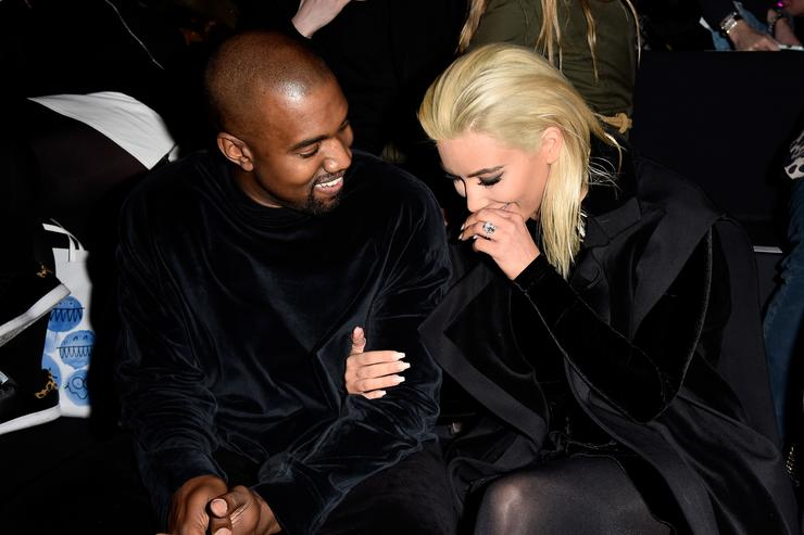 Kim Kardashian and Kanye West attend the Balmain show as part of the Paris Fashion Week Womenswear Fall/Winter 2015/2016 on March 5, 2015 in Paris, France.