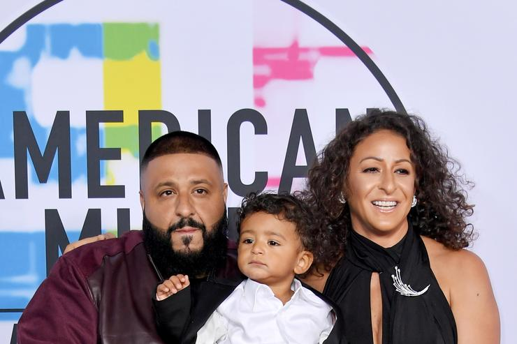 dj khaled with nicole tuck and asahd khaled on the AMA red carpet